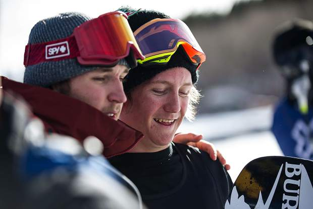 Summit County locals Chris Corning, left, and Red Gerard, both of Silverthorne, hug after Gerard posted a 92.00 on his second run on Thursday to qualify for Saturday's men's snowboard slopestyle final at X Games Aspen. Corning took third with an 84.00 to qualify in third place while Gerard posted Thursday's top score.