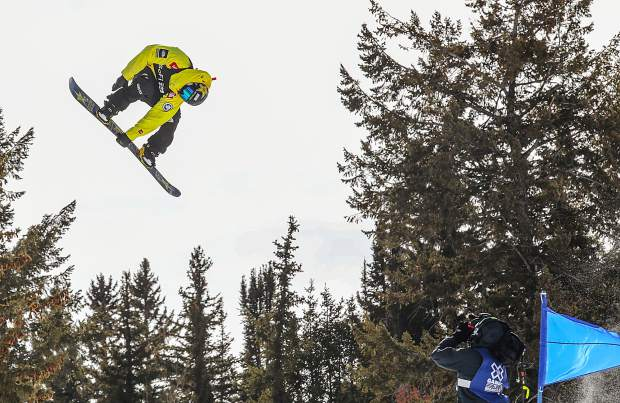 Kyle Mack grabs off the hip hit during the X Games Aspen slopestyle qualifiers on Thursday at Buttermilk Mountain.