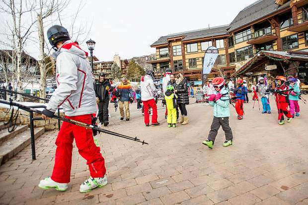 3b81152a2638 Ski and snowboard instructors gather their students for a lesson at  Snowmass Mountain at Base Village on Saturday morning. Anna Stonehouse The  Aspen Times