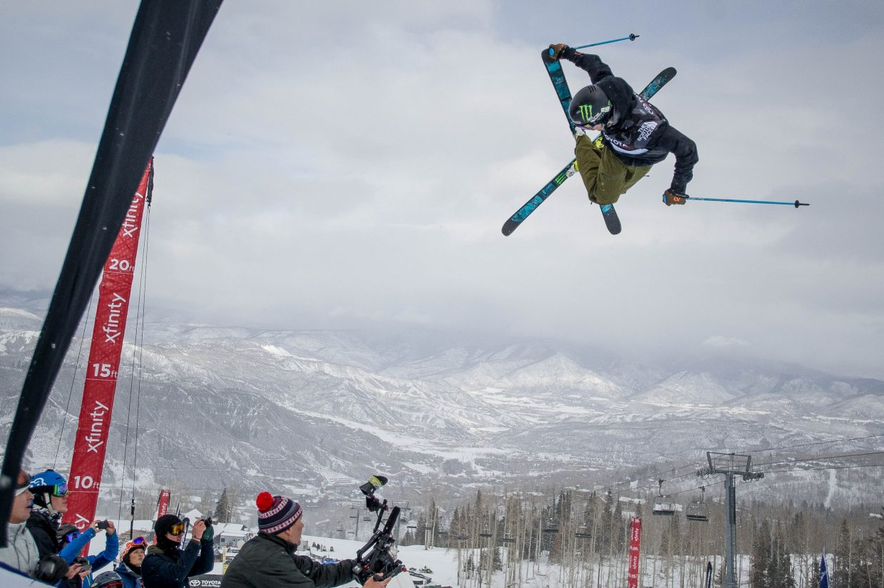 David Wise boosting out of the superpipe on his first run for the men's ski superpipe finals at the Snowmass U.S. Grand Prix competition on Friday. Wise landed first place with a 95 on his first run.