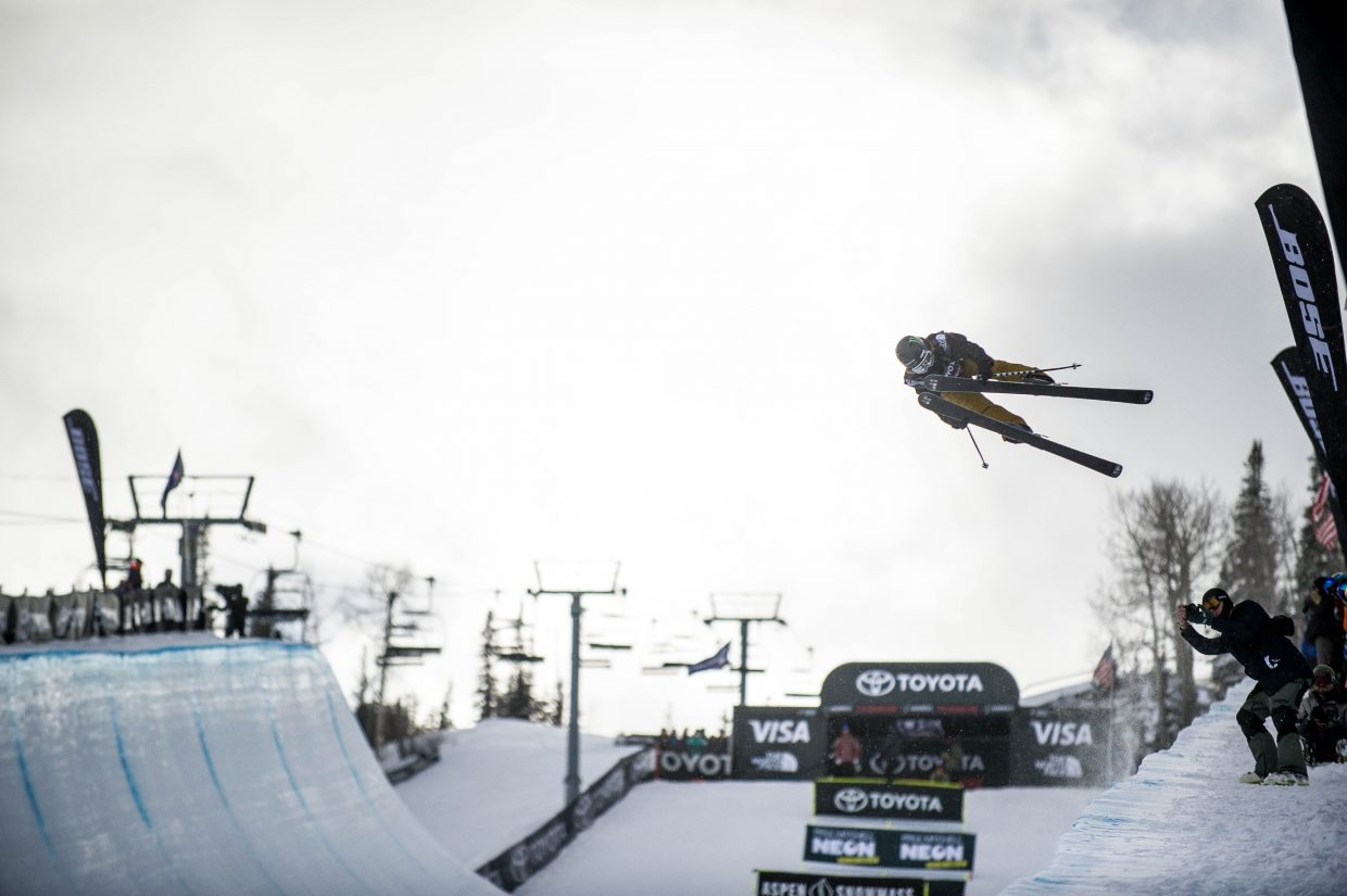 Canadian Cassie Sharpe does a truck driver grab on her second run for the women's ski superpipe finals at the Snowmass Grand Prix on Friday. Sharpe took first place overall.