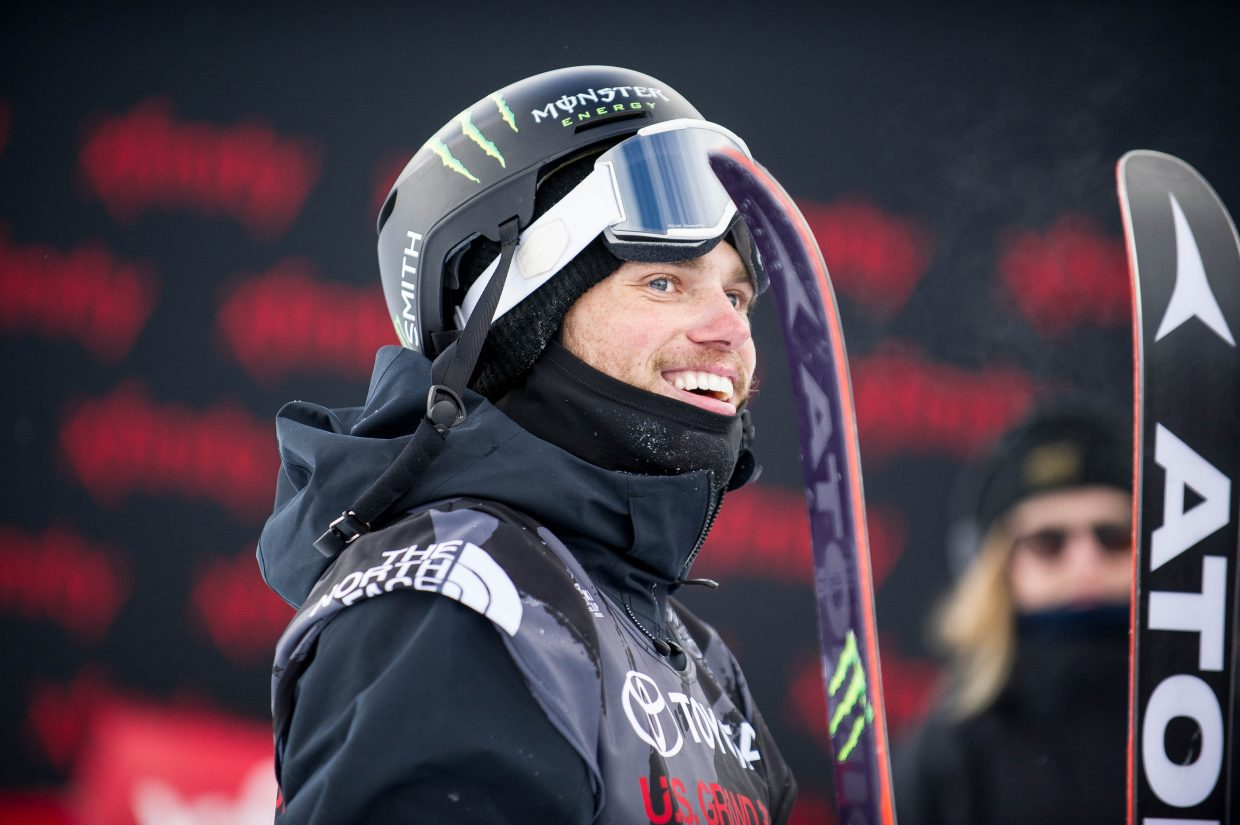 Gus Kenworthy awaits his score at the end of the pipe after completing one of his runs for the men's superpipe ski finals in Snowmass for the U.S. Grand Prix on Friday.