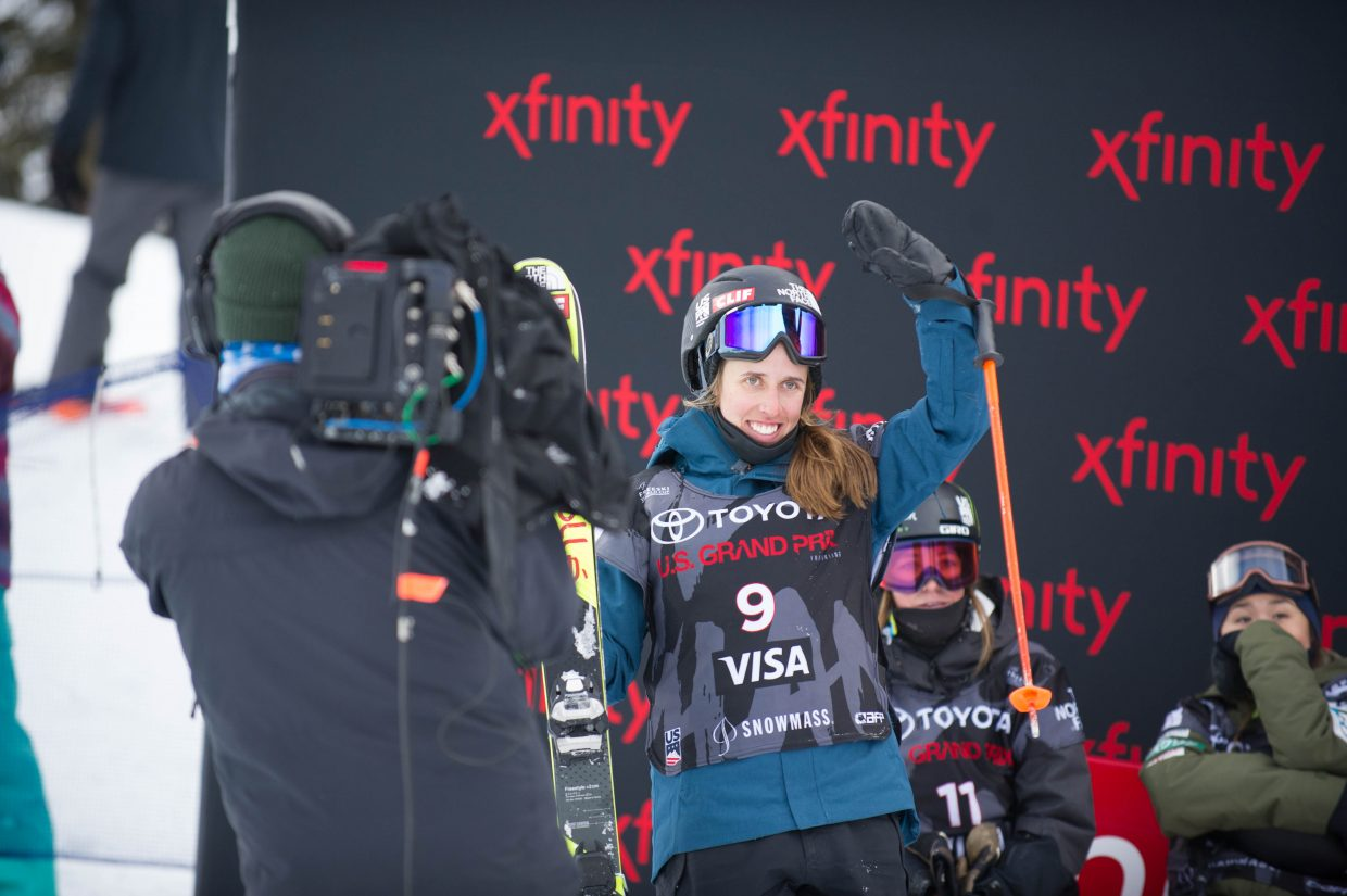 Maddie Bowman waves to the crowd after receiving her score for her third run for the women's freeski superpipe finals in Snowmass on Friday at the U.S. Grand Prix.