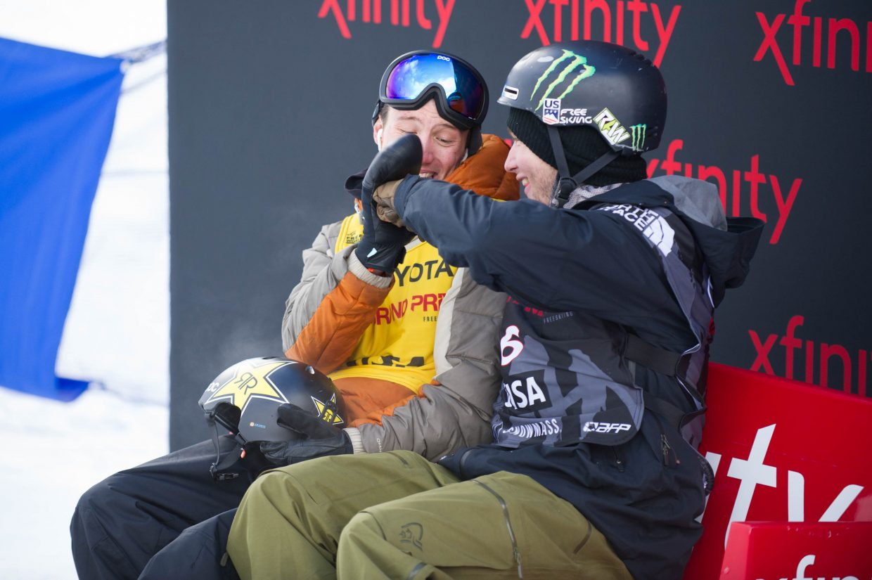 Aspen's Alex Ferreira, left, and David Wise fist bump while they wait for Aaron Blunck to complete his final run for the men's ski superpipe finals in Snowmass on Friday at the U.S. Grand Prix. Wise took first, Ferriera second, and Blunck took third.