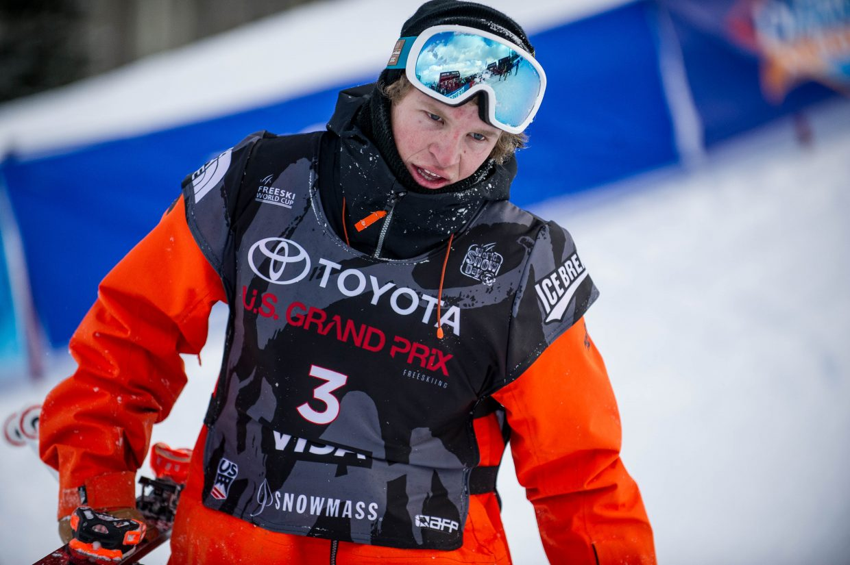 Aaron Blunck in pain after completing his third run and falling and ending up with a bruised heel on Friday for the men's ski superpipe finals in Snowmass for the U.S. Grand Prix. Blunck secured third place with one of his earlier runs.