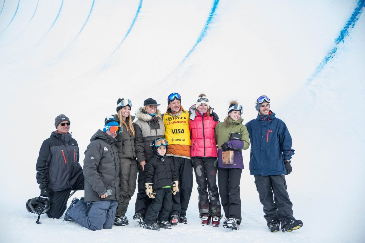 Local Aspen halfpipe skier poses for a photo with his friends and family and team members after securing second place on the podium for men's ski halfpipe finals at the U.S. Grand Prix in Snowmass on Friday.