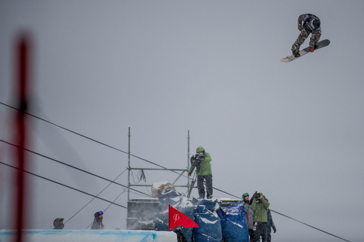 Tiarn Collins of New Zealand spinning off the second jump for the men's snowboard slopestyle finals at the U.S. Grand Prix in Snowmass on Friday. Collins took third place with a score of 83.57 with the last feature being closed due to weather.