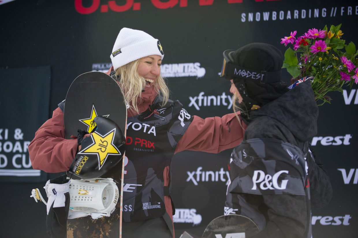 Christy Prior of New Zealand celebrates after taking first in slopestyle with Tess Coady of Australia who took third.