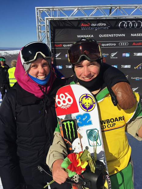 Nichole Mason poses for a photo with snowboarder Chris Corning after his first World Cup podium in 2015 in New Zealand.