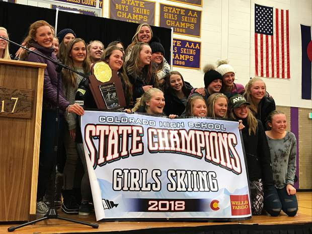 The Aspen High School girls ski team celebrates on the podium after winning the state championship on Friday in Leadville. It is the Skiers eighth state title in school history, and first since 2016.