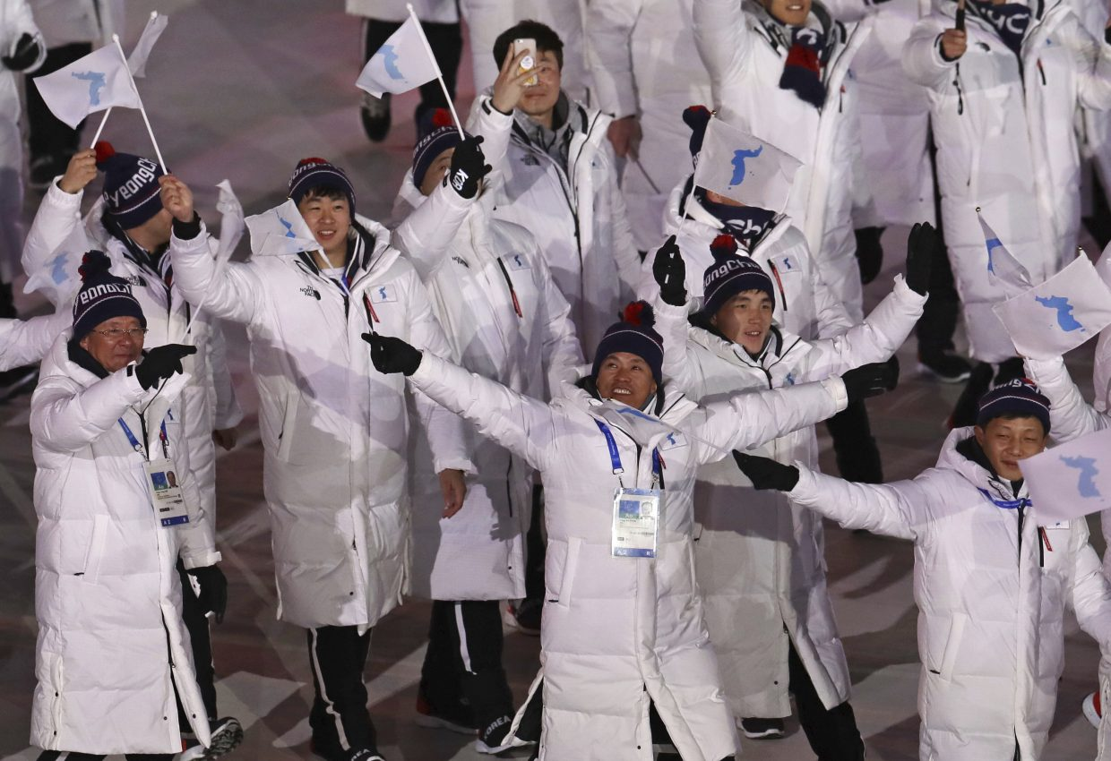 Korean athletes wave during the opening ceremony of the 2018 Winter Olympics in Pyeongchang, South Korea, Friday, Feb. 9, 2018. (AP Photo/Michael Sohn)