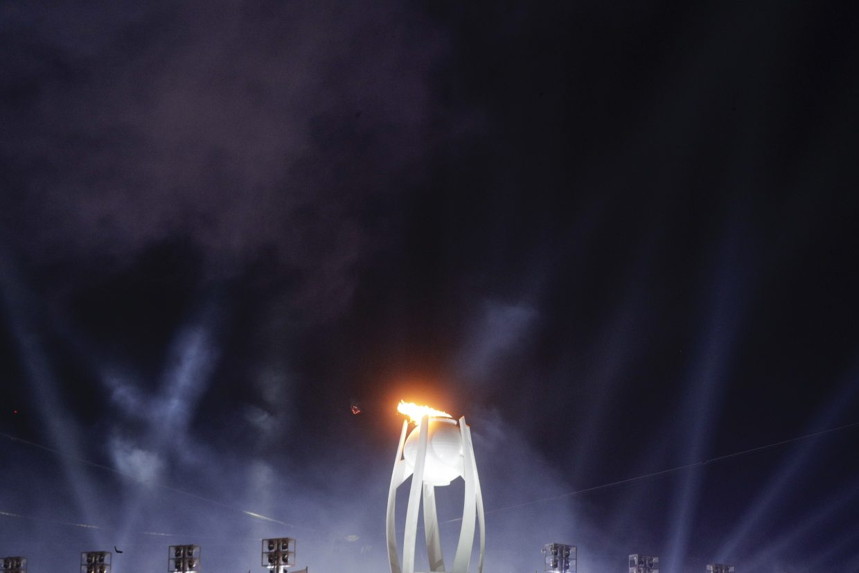 The Olympic flame is lit during the opening ceremony of the 2018 Winter Olympics in Pyeongchang, South Korea, Friday, Feb. 9, 2018. (AP Photo/Gregorio Borgia)