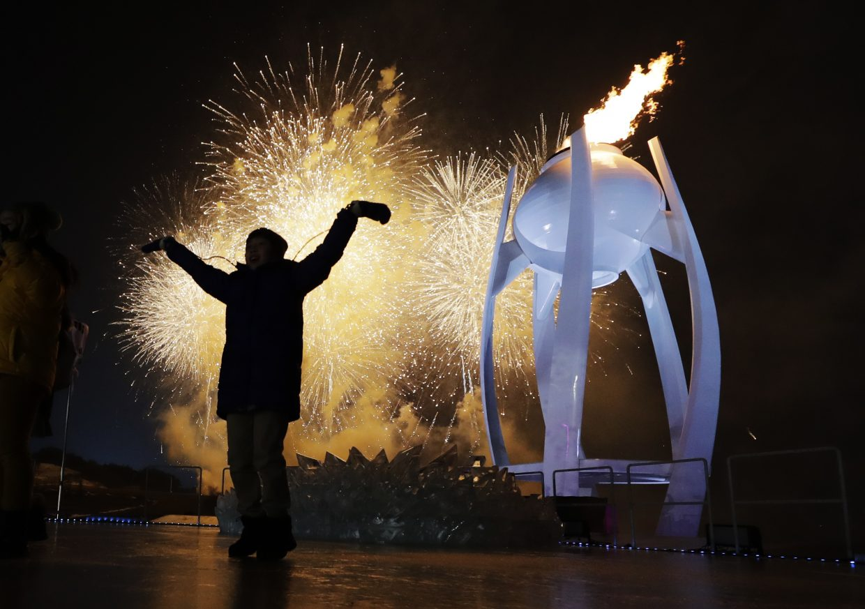 A young performer participates in the opening ceremony of the 2018 Winter Olympics in Pyeongchang, South Korea, Friday, Feb. 9, 2018. (AP Photo/David J. Phillip, Pool)
