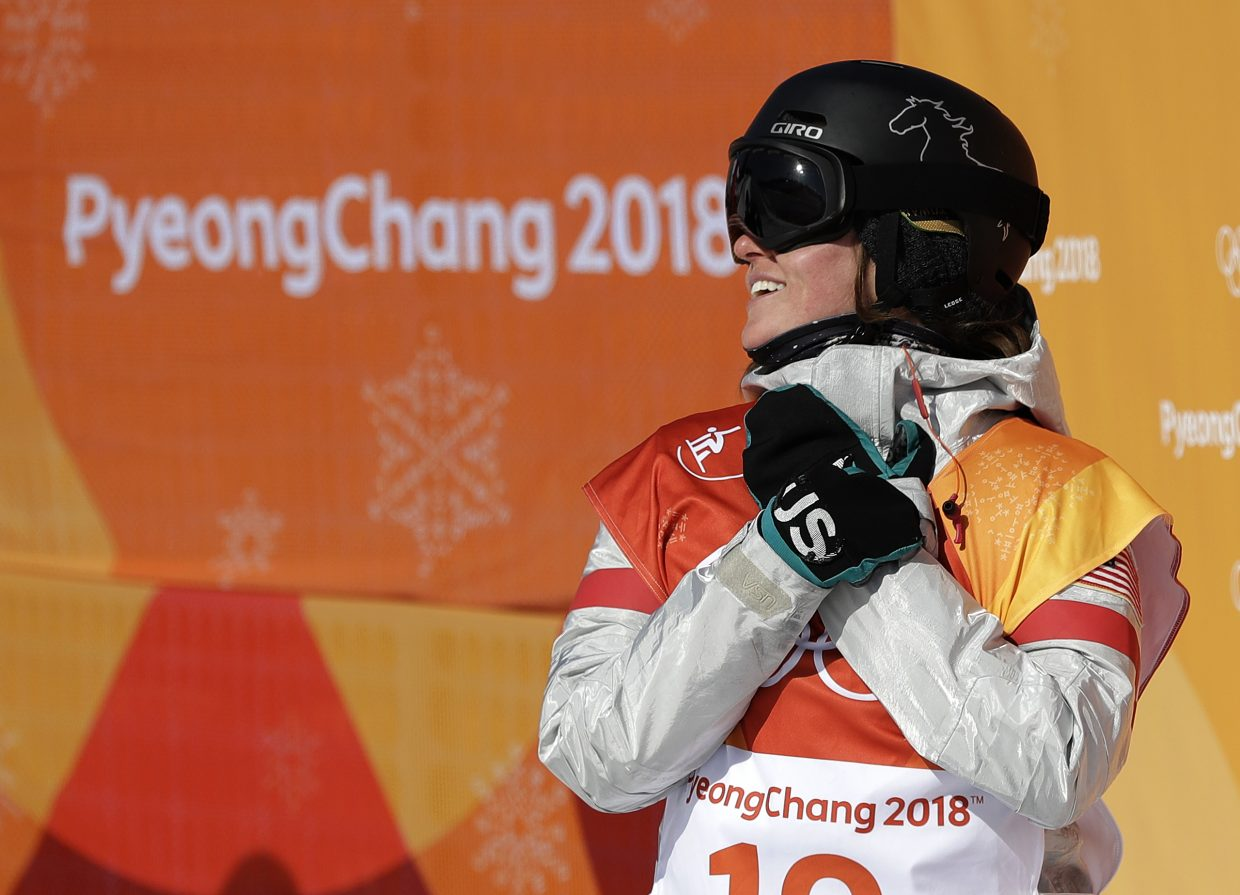 Arielle Gold, of the United States, reacts to her score during the women's halfpipe finals at Phoenix Snow Park at the 2018 Winter Olympics in Pyeongchang, South Korea, Tuesday, Feb. 13, 2018. (AP Photo/Gregory Bull)