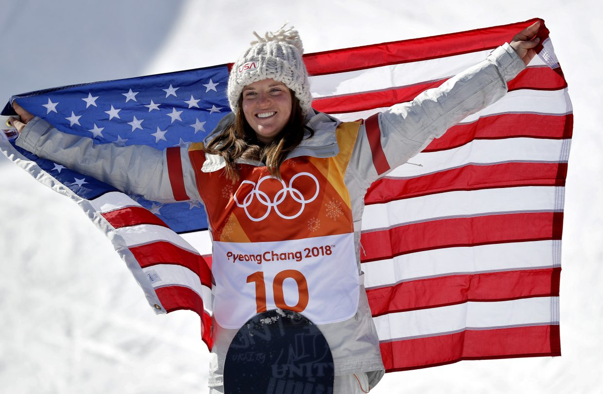Arielle Gold, of the United States, celebrates winning bronze in the women's halfpipe finals at Phoenix Snow Park at the 2018 Winter Olympics in Pyeongchang, South Korea, Tuesday, Feb. 13, 2018. (AP Photo/Gregory Bull)