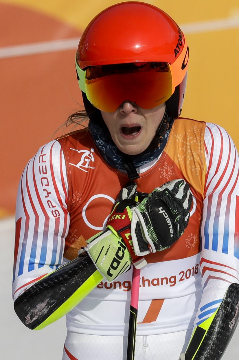 Gold medalist, Mikaela Shiffrin, of the United States, reacts to her victory after the second run of the Women's Giant Slalom at the 2018 Winter Olympics in Pyeongchang, South Korea, Thursday, Feb. 15, 2018., Thursday, Feb. 15, 2018. (AP Photo/Michael Probst)