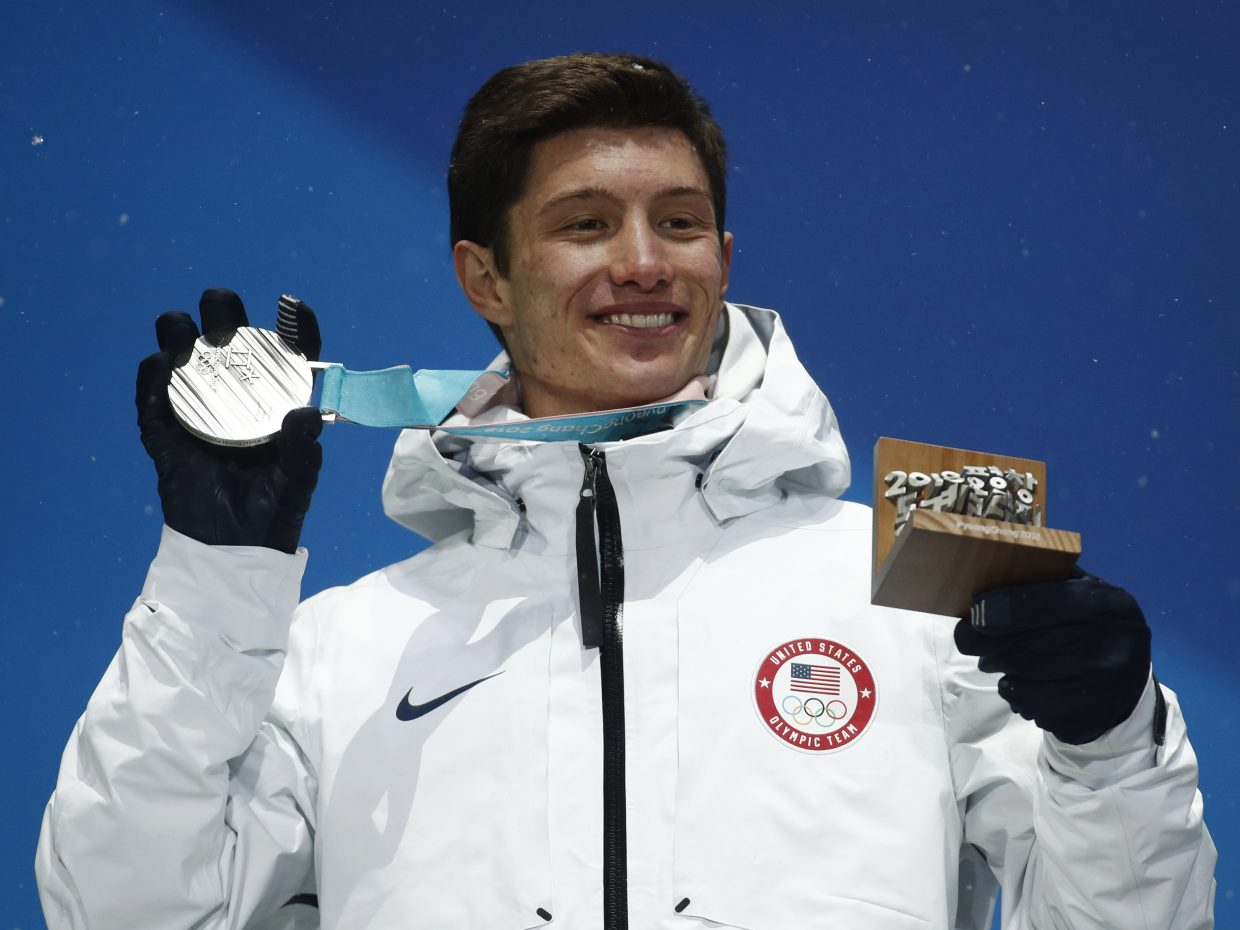 Silver medalist in the men's halfpipe AlexFerreira, of the United States, poses during the medals ceremonyat the 2018 Winter Olympics in Pyeongchang, South Korea, Thursday, Feb. 22, 2018. (AP Photo/Patrick Semansky)