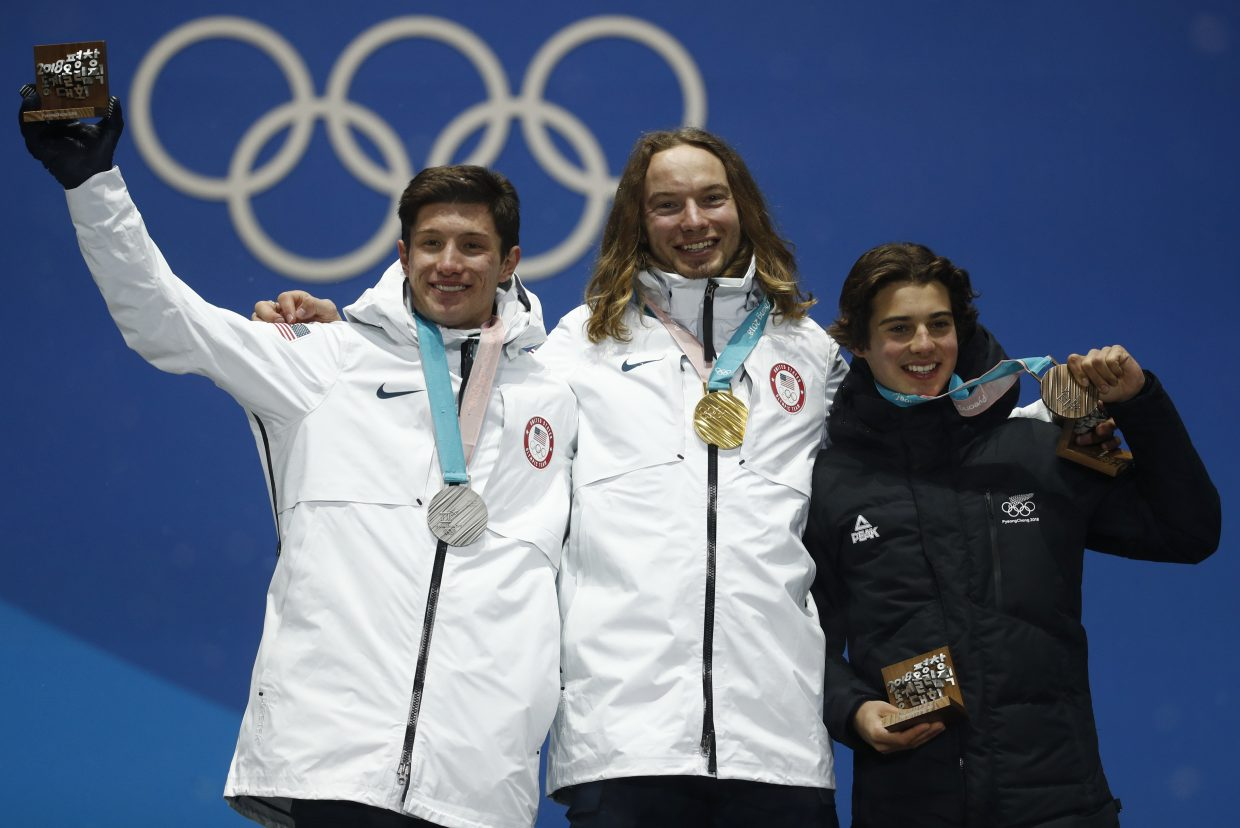 Medalists in the men's halfpipe, from left, United States' Alex Ferreira, silver, United States' David Wise, gold, and New Zealand's Nico Porteous, bronze, pose during their medals ceremony at the 2018 Winter Olympics in Pyeongchang, South Korea, Thursday, Feb. 22, 2018. (AP Photo/Patrick Semansky)