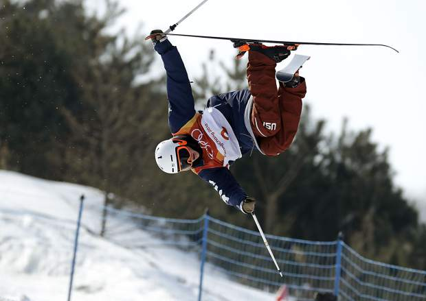 Aaron Blunck, of the United States, jumps during the men's halfpipe qualifying at Phoenix Snow Park at the 2018 Winter Olympics in Pyeongchang, South Korea, Tuesday, Feb. 20, 2018. (AP Photo/Kin Cheung)