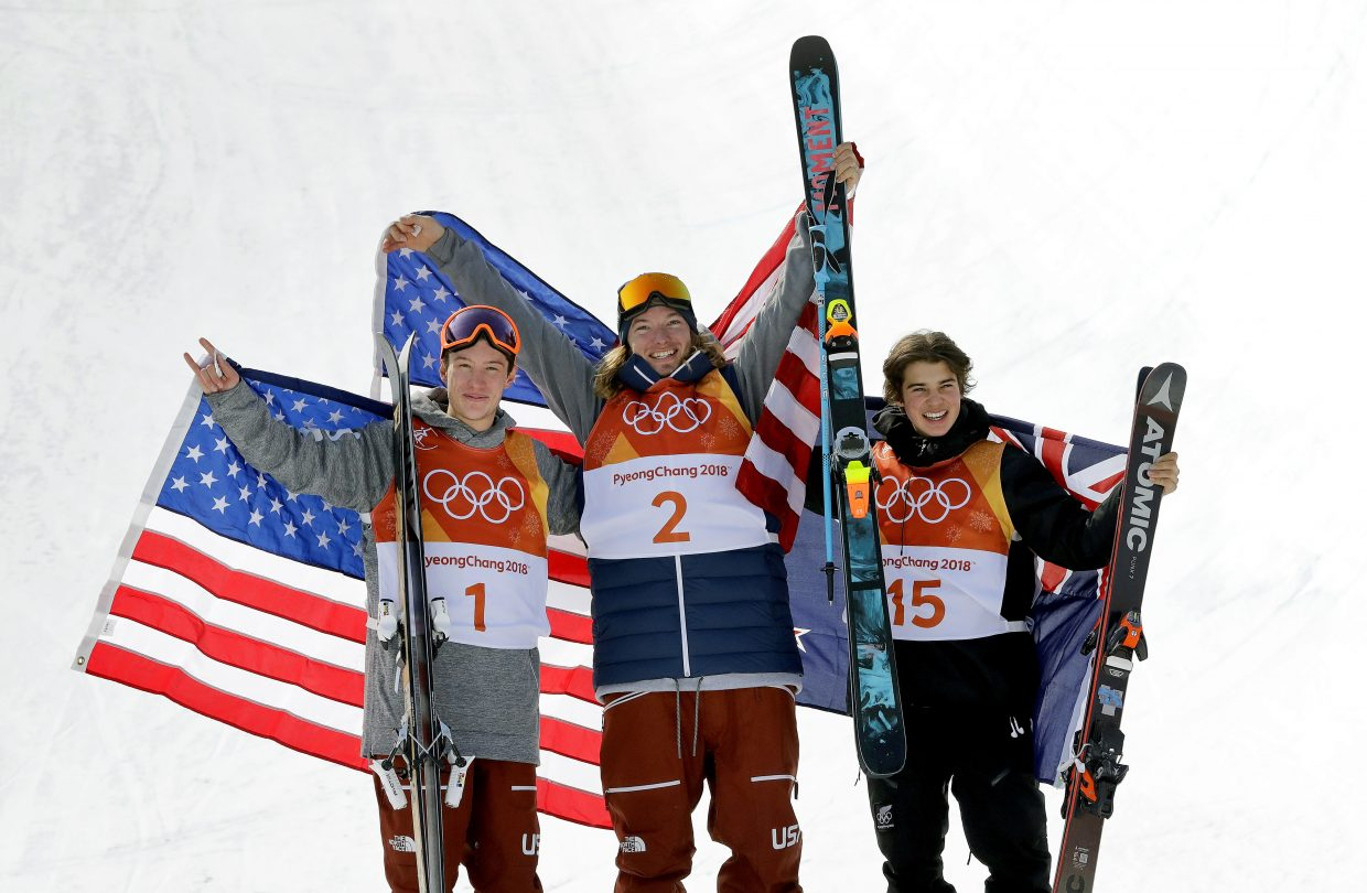 From left; Silver medal winner Alex Ferreira, of the United States, gold medal winner David Wise, of the United States, and bronze medal winner Nico Porteous, of New Zealand, celebrate after the men's halfpipe final at Phoenix Snow Park at the 2018 Winter Olympics in Pyeongchang, South Korea, Thursday, Feb. 22, 2018. (AP Photo/Lee Jin-man)