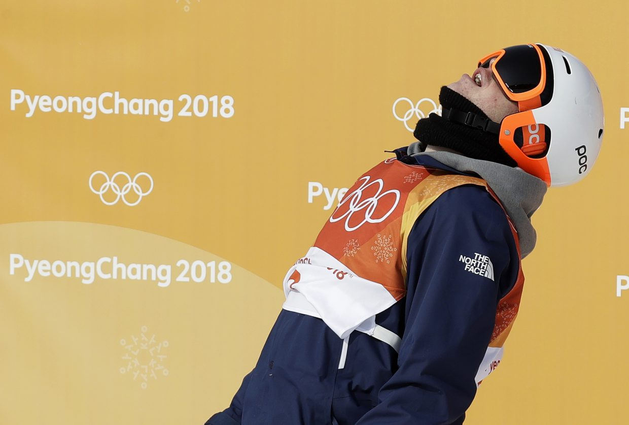 Aaron Blunck, of the United States, reacts after his run during the men's halfpipe qualifying at Phoenix Snow Park at the 2018 Winter Olympics in Pyeongchang, South Korea, Tuesday, Feb. 20, 2018. (AP Photo/Kin Cheung)