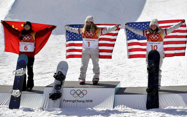 Gold winner Chloe Kim, of the United States, (1), silver winner Liu Jiayu, of China, (6) and bronze winner Arielle Gold, of the United States, (10), celebrate after the womn's halfpipe finals at Phoenix Snow Park at the 2018 Winter Olympics in Pyeongchang, South Korea on Tuesday, Feb. 13.