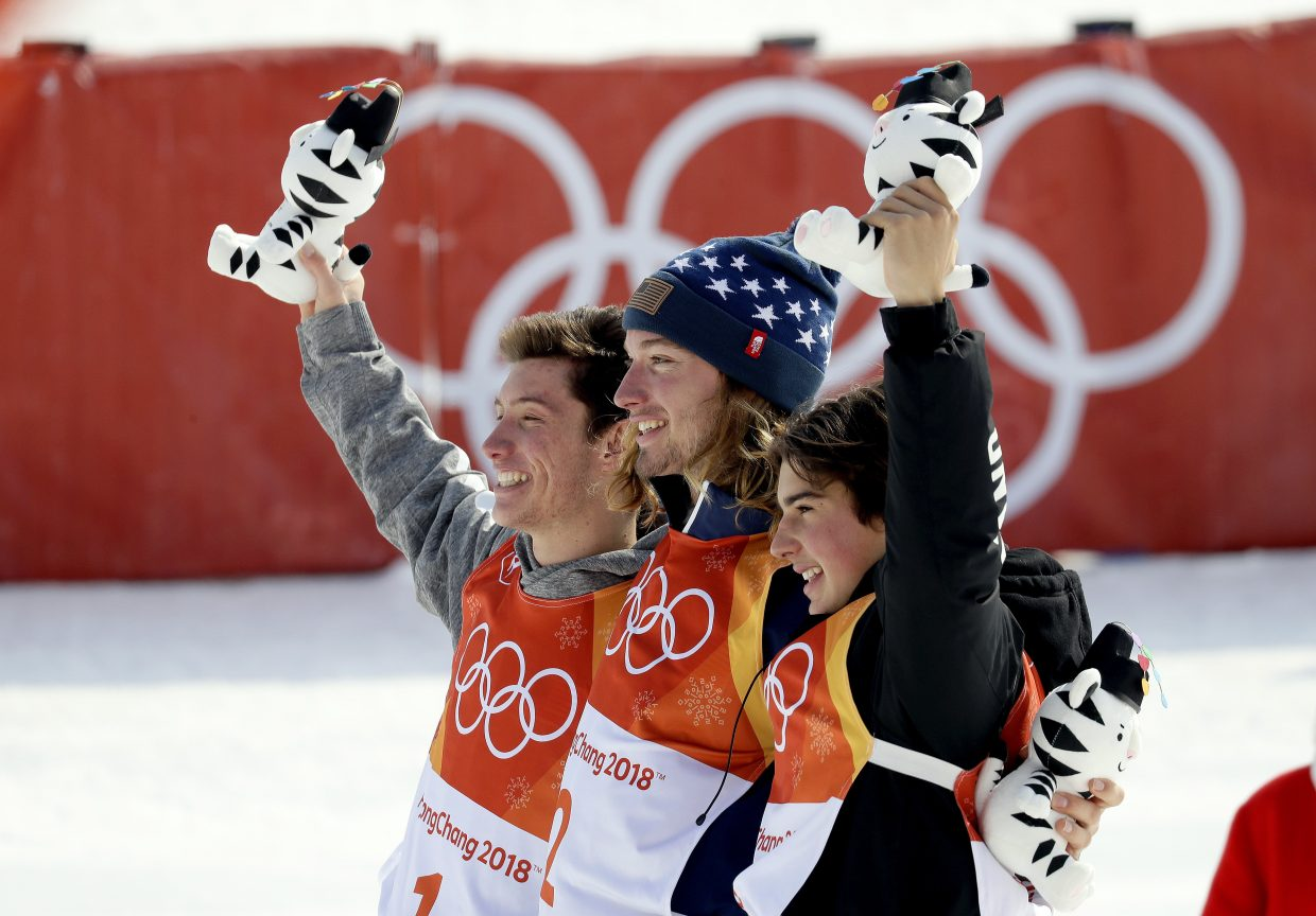 From left; Silver medal winner AlexFerreira, of the United States, gold medal winner DavidWise, of the United States, and bronze medal winner NicoPorteous, of New Zealand, celebrate after the men's halfpipe finals at Phoenix Snow Park at the 2018 Winter Olympics in Pyeongchang, South Korea, Thursday, Feb. 22, 2018. (AP Photo/Kin Cheung)