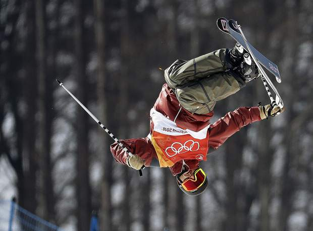 Noah Bowman, of Canada, jumps during the men's halfpipe final at Phoenix Snow Park at the 2018 Winter Olympics in Pyeongchang, South Korea, Thursday, Feb. 22, 2018. (AP Photo/Lee Jin-man)