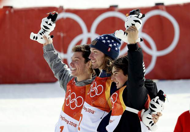 From left; Silver medal winner Alex Ferreira, of the United States, gold medal winner David Wise, of the United States, and bronze medal winner Nico Porteous, of New Zealand, celebrate after the men's halfpipe finals at Phoenix Snow Park at the 2018 Winter Olympics in Pyeongchang, South Korea, Thursday, Feb. 22, 2018. (AP Photo/Kin Cheung)