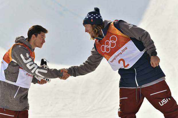David Wise of the United States and Alex Ferreira of the United States celebrate after winning gold and silver, respectively, during the freeskiing men's halfpipe final Thursday at the PyeongChang 2018 Winter Olympic Games at Phoenix Snow Park. (Photo by Hyoung Chang/The Denver Post)