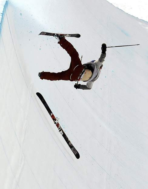 Torin Yater-Wallace, of the United States, crashes during the men's halfpipe final at Phoenix Snow Park at the 2018 Winter Olympics in Pyeongchang, South Korea, Thursday, Feb. 22, 2018. (AP Photo/Lee Jin-man)