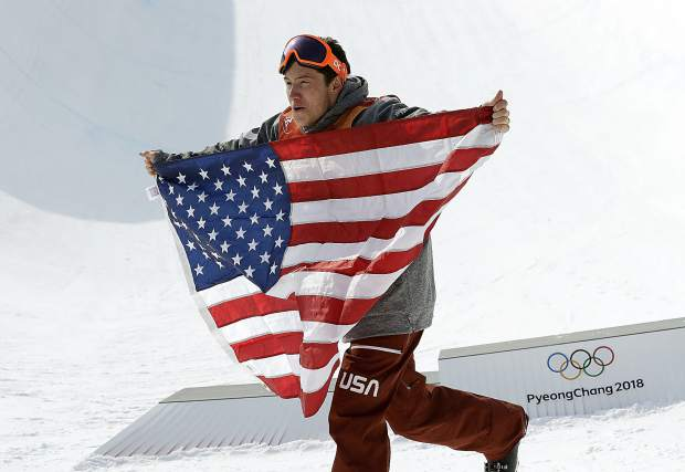 Silver medal winner AlexFerreira, of the United States, celebrates after the men's halfpipe final at Phoenix Snow Park at the 2018 Winter Olympics in Pyeongchang, South Korea, Thursday, Feb. 22, 2018. (AP Photo/Lee Jin-man)