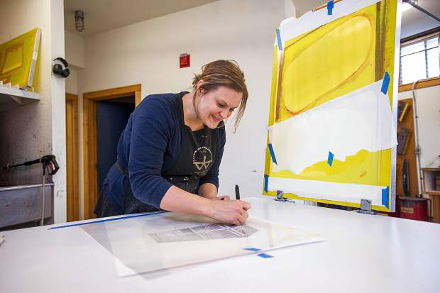 Anderson Ranch artist in residence Kristina Paabus screen printing for her current works in progress on Friday.