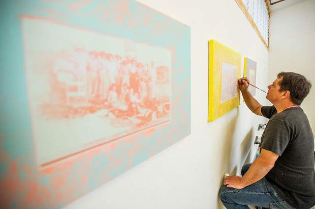 Painting and drawing artist in residence at Anderson Ranch Tony De Los Reyes working on his Border Theory series on Friday.
