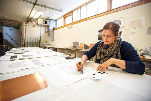 Anderson Ranch artist in residence Kristina Paabus sketching out drafts for her current works in progress on Friday.