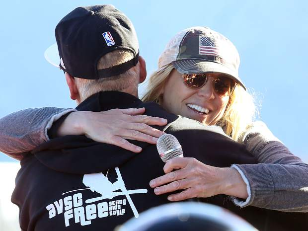 Elana Chase, Alex Ferreira's longtime coach, gets a hug from Eric Knight, the freestyle program director at the Aspen Valley Ski and Snowboard Club, during Friday's celebration at the top of Aspen Mountain.