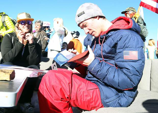 Alex Ferreira signs autographs at the top of Aspen Mountain on Friday. An Aspen local, the halfpipe skier won Olympic silver at the 2018 Winter Olympics last month in South Korea.