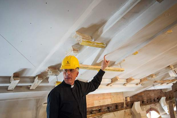 Rev. John Hilton shows off the beginnings of a coffered ceiling on the third level of St. Mary Church.
