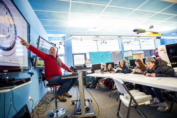 Aero class teacher Greg Roark points to the screen showing the E6-B flight computer at Aspen Middle School on Wednesday.
