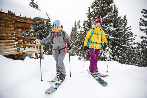 Gretchen Bleiler and Jordie Karlinski splitboarding up on Richmond Ridge in Aspen.