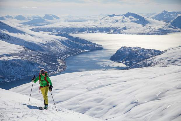 Christy Mahon skinning up Tromsdalstinden, a peak looking over the northern city of Tromso, Norway.