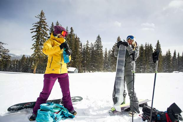 Gretchen Bleiler and Jordie Karlinski pack up their skins after splitboarding up on Richmond Ridge in Aspen.