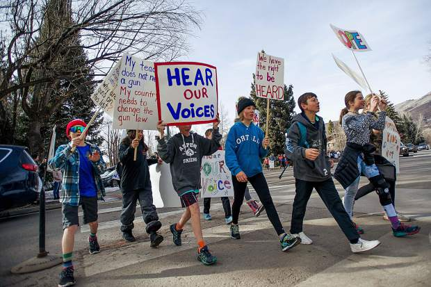 Aspen Middle School students and other supporters march protesting gun violence and in support of gun control for National Walkout Day on Wednesday from the Middle School to Paepcke Park. Wednesday marked the 1 month anniversary of the Parkland Florida school shooting.