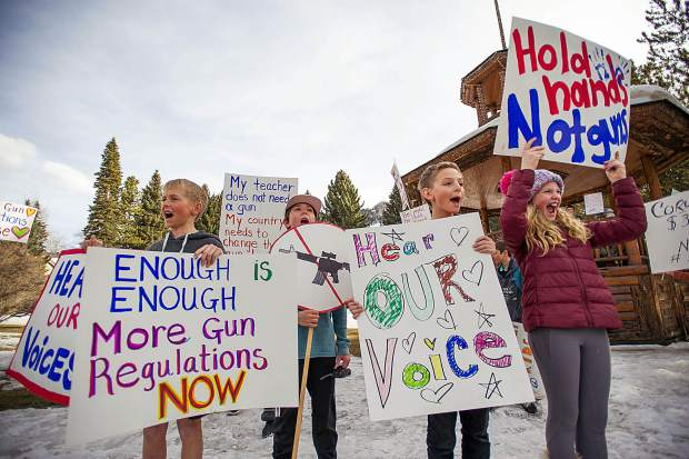 Aspen Middle School students and other supporters chant anti-gun proclamations after marching protesting gun violence and in support of gun control for National Walkout Day on Wednesday from the Middle School to Paepcke Park. Wednesday marked the 1 month anniversary of the Parkland Florida school shooting.