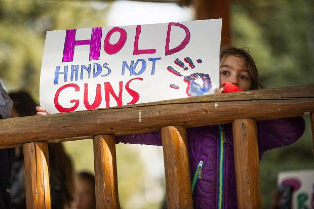 Trinidad Palasz, 6, holds an anti-gun sign at the Paepcke Park gazebo on Wednesday. Aspen Middle School students and other supporters chant anti-gun proclamations after marching protesting gun violence and in support of gun control for National Walkout Day on Wednesday from the Middle School to Paepcke Park. Wednesday marked the 1 month anniversary of the Parkland Florida school shooting.