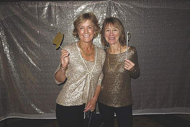 Robin Van Domelen and Lynn Whitmer looking gorgeous in gold.