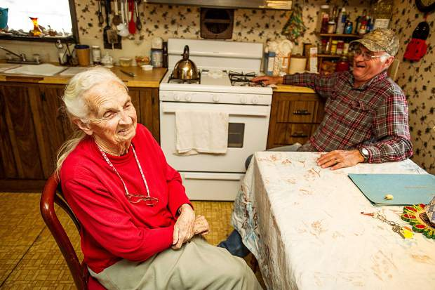 Harriett Noyes and her son, Hyrum Noyes, laugh at her kitchen table Sunday as they reminisce about life in the upper Roaring Fork Valley before the advent of skiing and incredible wealth.