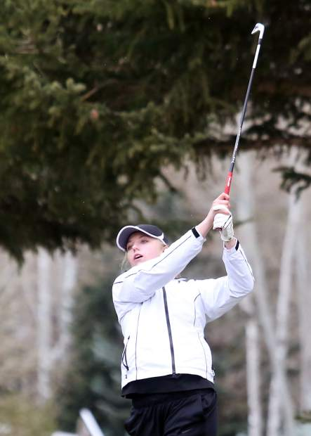 Grand Junction's Gracie Olkowski hits her approach shot during Tuesday's round at Aspen Golf Club. Olkowski shot 1-under-par 69 to win the tournament, hosted by Aspen High School.