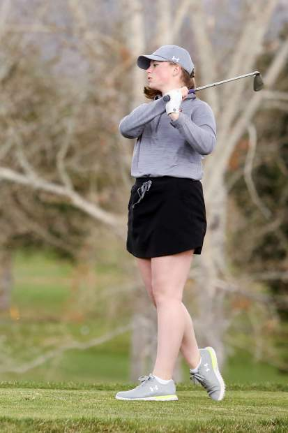 Aspen High School sophomore Avery Hirsch tees off on Tuesday at Aspen Golf Club.