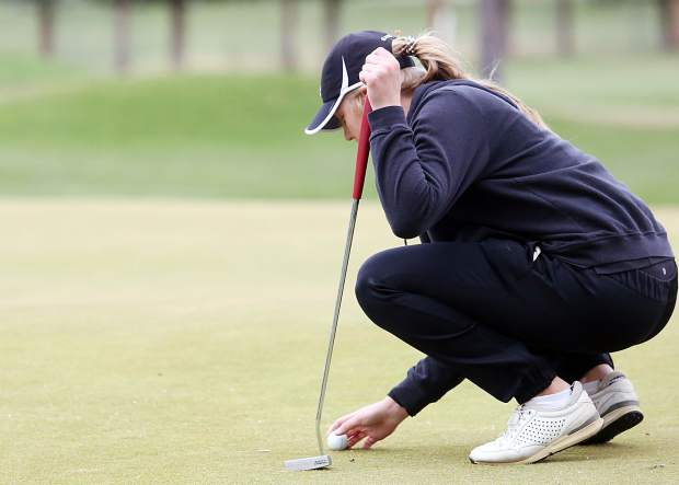 Grand Junction's Gracie Olkowski lines up her putt on Tuesday at Aspen Golf Club.